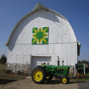 This barn quilt can be found at Gale and Nancy Getschman's place, 1805 W. Pine St. (Cty Rd. BP), Baraboo.  The pattern is the Wisconsin Star and was painted green and yellow honoring Gale's John Deere tractor collection.